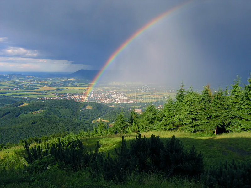 Rainbow in the mountains. Beautiful rainbow in the Beskids mountains, Czech republic, Europe royalty free stock image