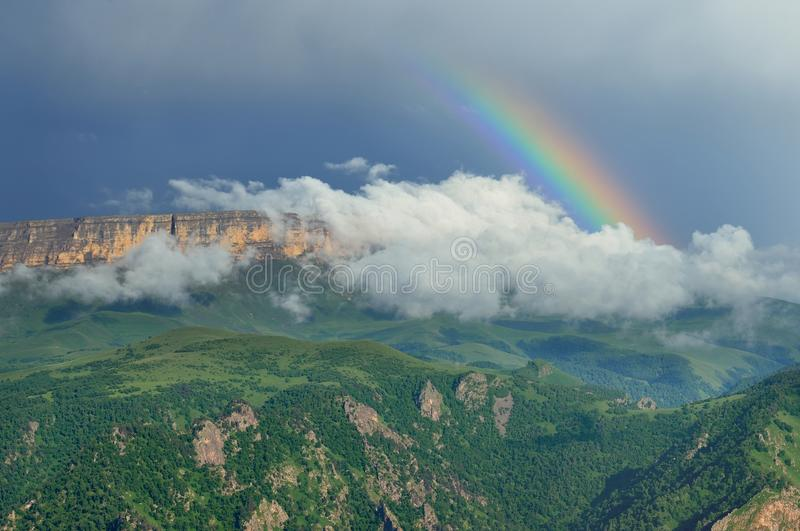 Rainbow in mountains. This is colorful rainbow in Caucasus mountains in summer stock photo
