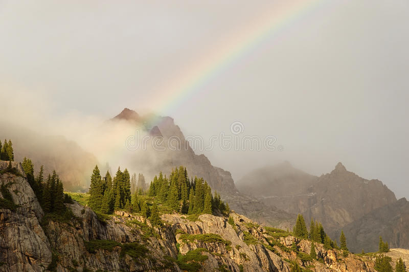 Rainbow in mountains. Rainbow in the Dzungarian Alatau mountains, Kazakhstan royalty free stock photo