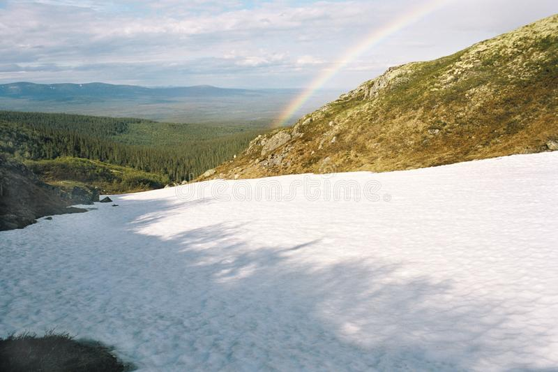 Rainbow in mountains. Murmansk area. Peninsula Kola royalty free stock photo