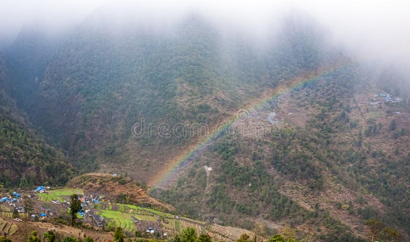 Rainbow in mountains of Nepal.  royalty free stock photography