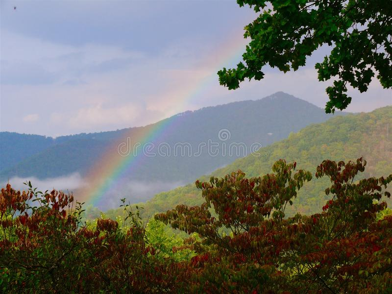 Rainbow in the Mountains. Rainbow over the Blue Ridge Mountains in North royalty free stock photography
