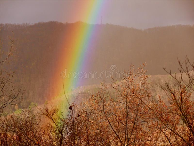 Rainbow in the Mountains. Rainbow over the Blue Ridge Mountains in North royalty free stock photo