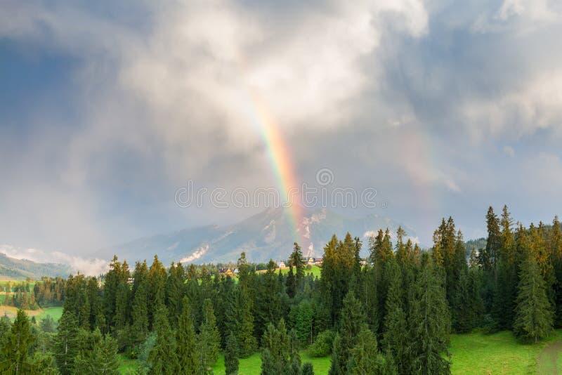 Rainbow in the mountains. Rainbow in the Polish Slovak Tatra mountains stock image