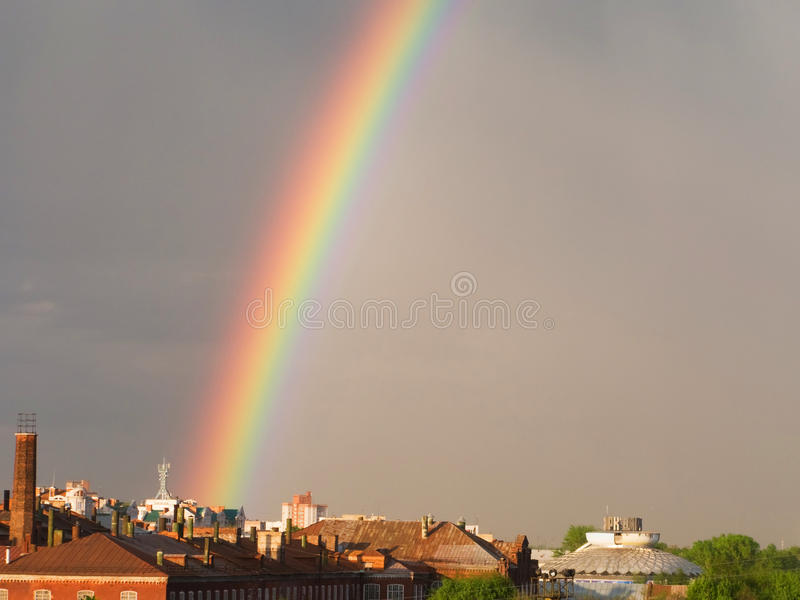 Rainbow multi color image in blue sky rain nature stock images