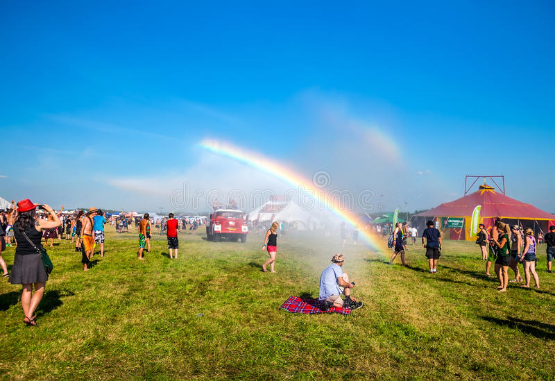Rainbow in music festival. JULY 2013, People watching at rainbow from a fire truck water at Mighty Sounds festival, Czech Republic, July 19, 2013 stock image