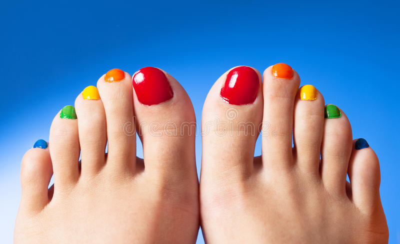Rainbow nail polish feet royalty free stock images