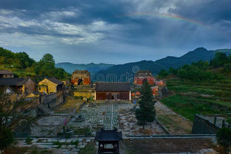 Rainbow over the ancient kung fu temple on the top of mountain royalty free stock image