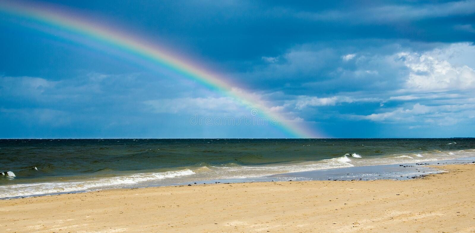 Rainbow over the Baltic Sea after the rain royalty free stock images