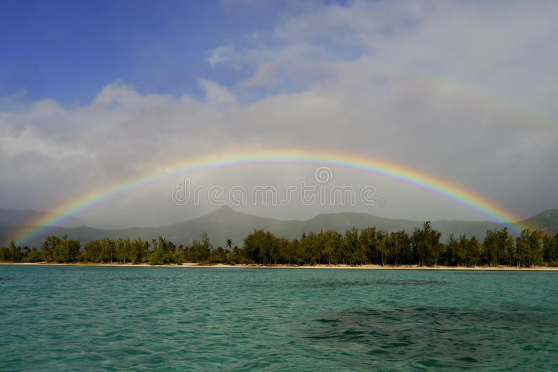 Rainbow over Benitiers Island, Mauritius stock photo