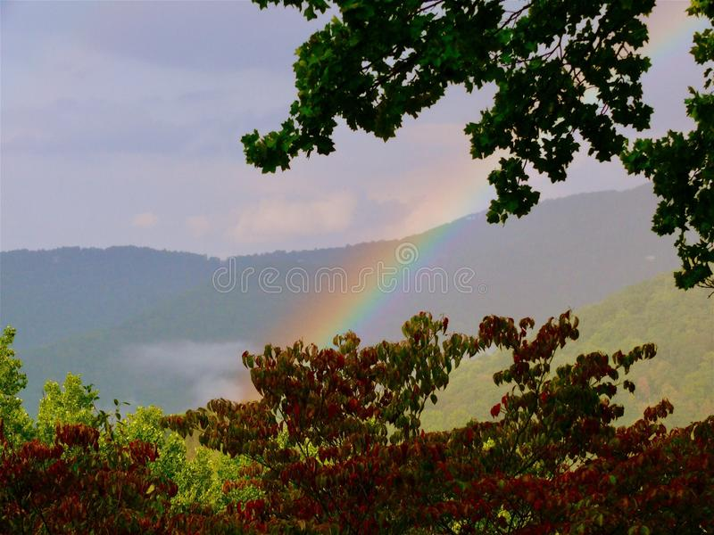 Rainbow in the Mountains. Rainbow over the Blue Ridge Mountains in North royalty free stock image
