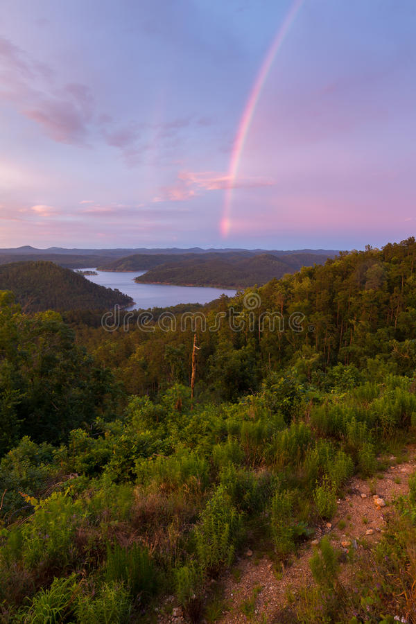 Rainbow Over Broken Bow Lake royalty free stock image
