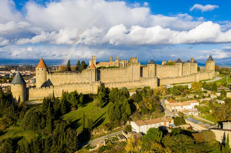 Rainbow over Cite de Carcassonne, a medieval hill-top citadel in the French city of Carcassonne, fortified by two castle walls. stock image
