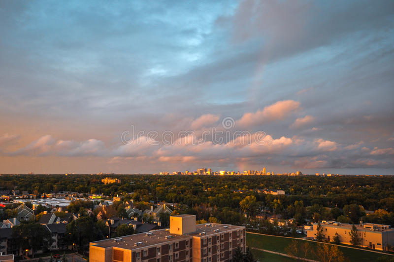 Rainbow over the city. Aerial view at the Winnipeg city during rainbow after rain stock images