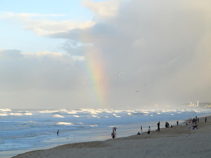 Stormy beach scenery with rainbow royalty free stock images
