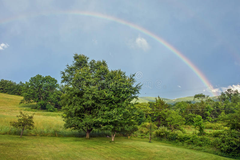 Rainbow Over Countryside royalty free stock photography