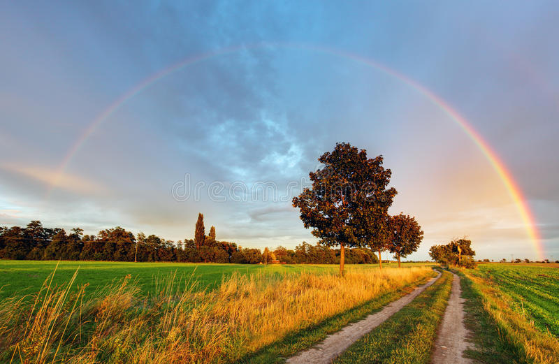 Download Rainbow over field road stock image. Image of field, colorful - 33797067