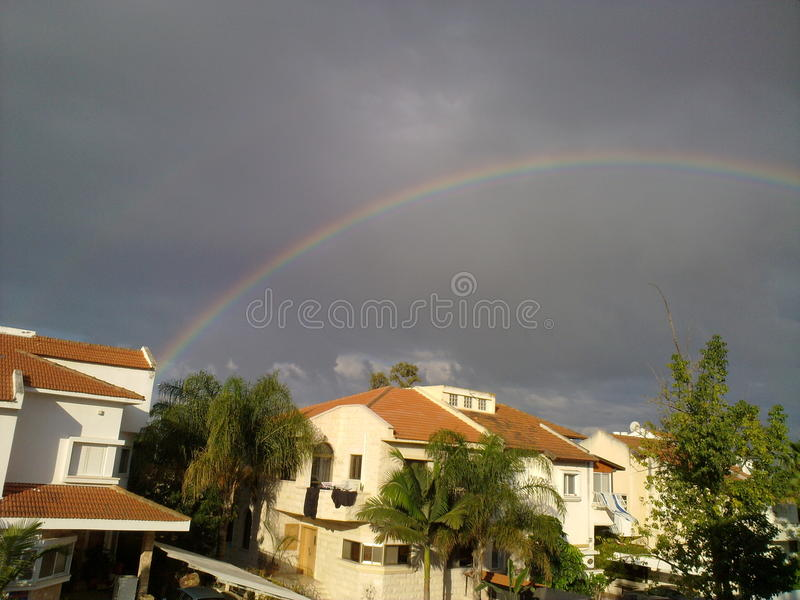 Rainbow over the houses stock images