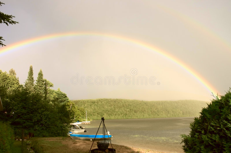 Download Rainbow over a lake 2 stock photo. Image of peaceful, natural - 2300478