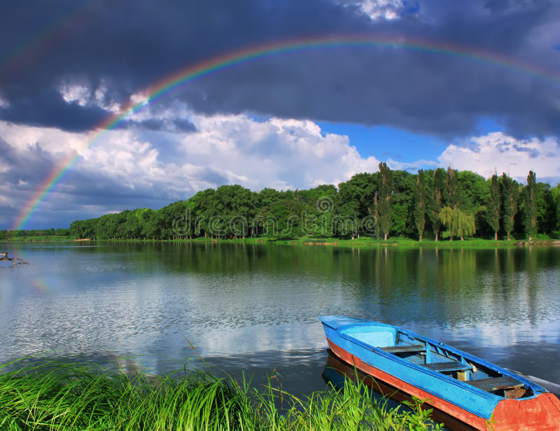 Download Rainbow Over The Lake With A Boat Stock Image - Image: 25653471