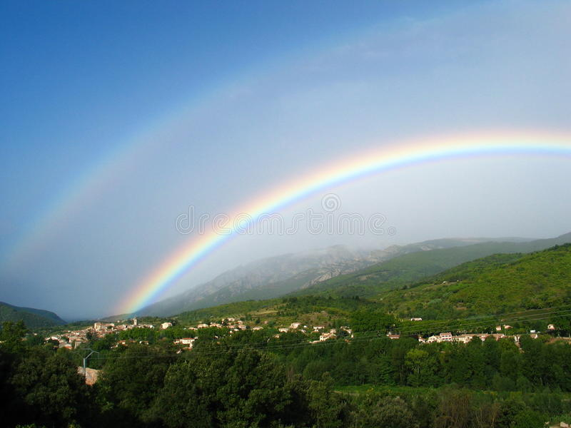 That Rainbow. Rainbow over Le Poujol-sur-Orb, southern France royalty free stock photo