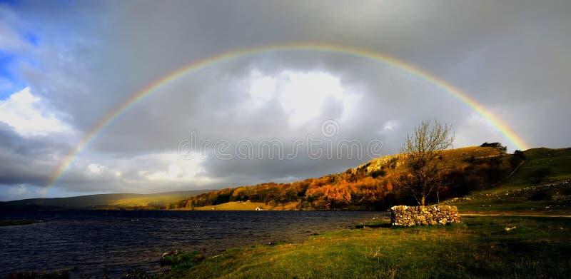 Rainbow over Malham Tarn. Rainbow over the wild waters of Malham Tarn royalty free stock images