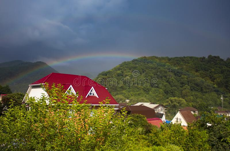 Rainbow over Mountain Housing royalty free stock photography