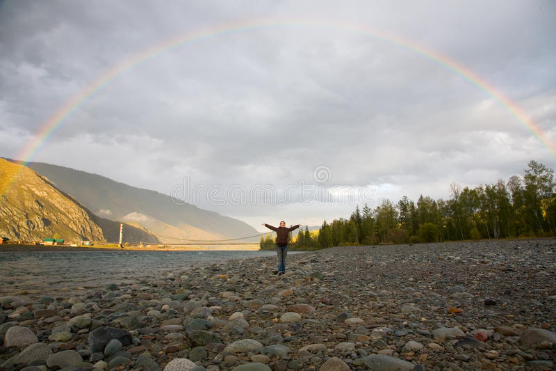 Rainbow over the mountain river royalty free stock photos
