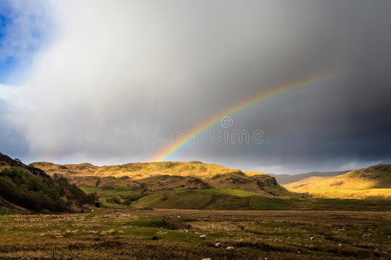 Rainbow over the mountains. In the scotisch highlands royalty free stock photos
