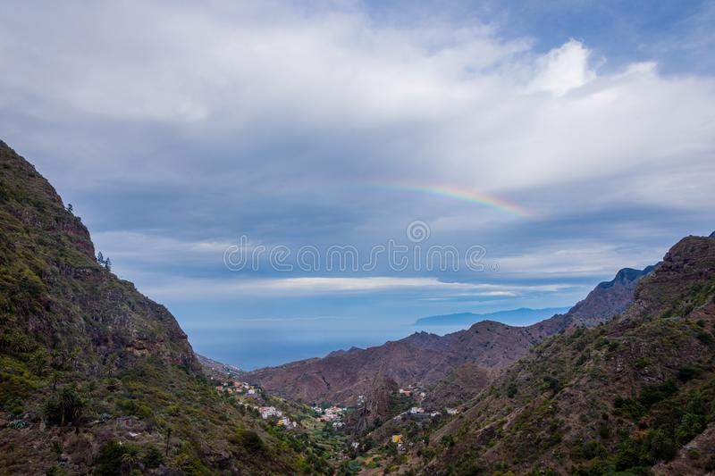Rainbow over the mountains of La Gomera stock photography