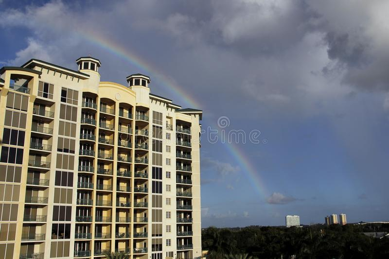 Rainbow over North Fort Myers, Florida. Rainbow over the North Star Yacht Club in North Fort Myers, Florida with a dark foreboding sky beyond. Near the Gulf of royalty free stock image