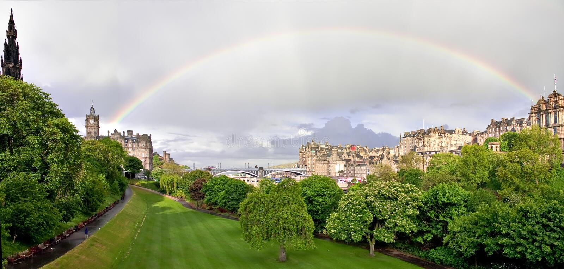 Rainbow over Princess street gardens in Edinburgh stock photo