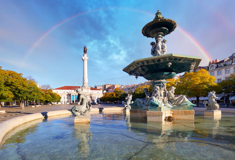 Rainbow over Rossio square in Lisbon Portugal royalty free stock images