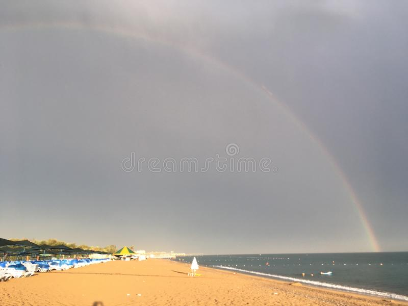 Rainbow over the sea and the beach in Belek stock images