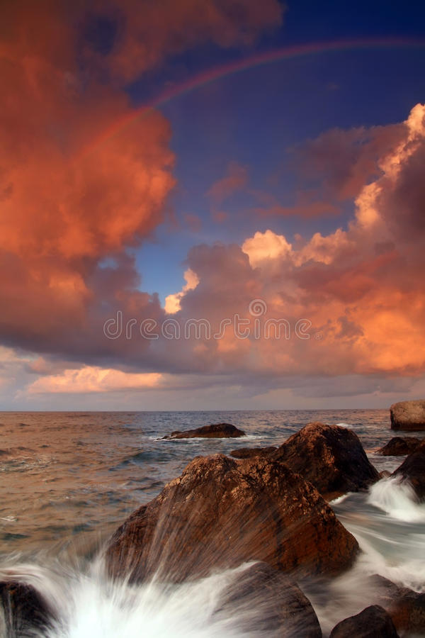 Rainbow over stormy sea