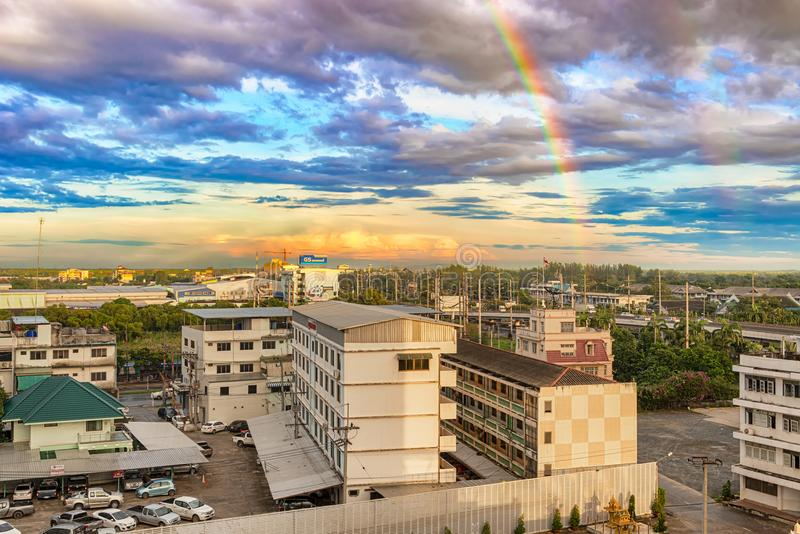 Rainbow over the town of Chachoengsao, Thailand. stock photography