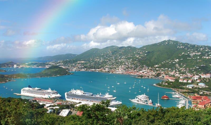 Rainbow over tropical island royalty free stock image
