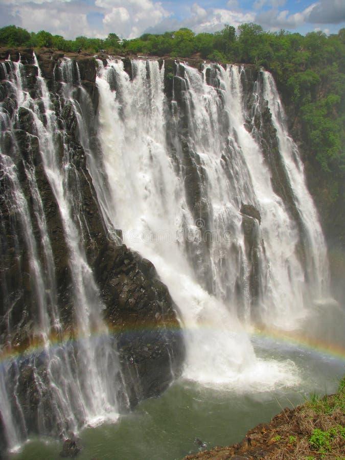Rainbow over Victoria Falls on Zambezi River stock photography