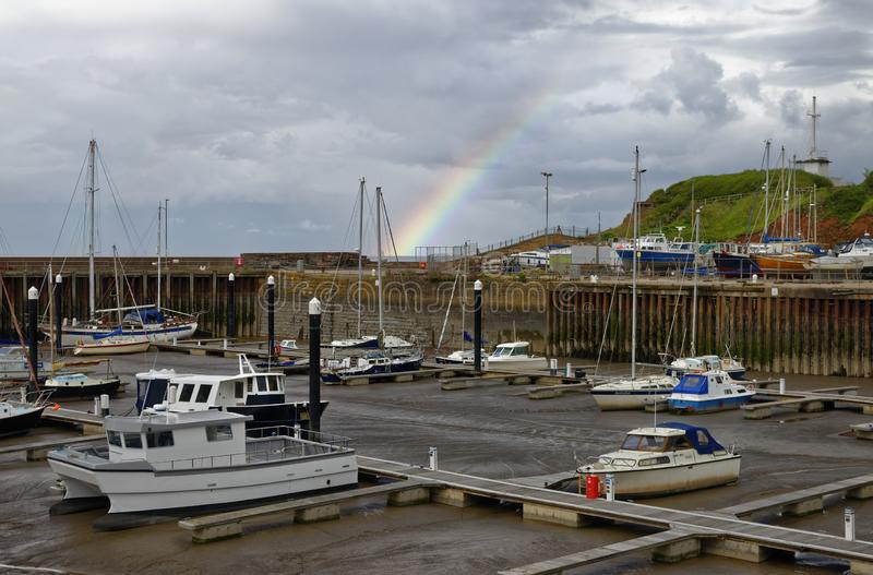 Rainbow over Watchet Harbour royalty free stock images