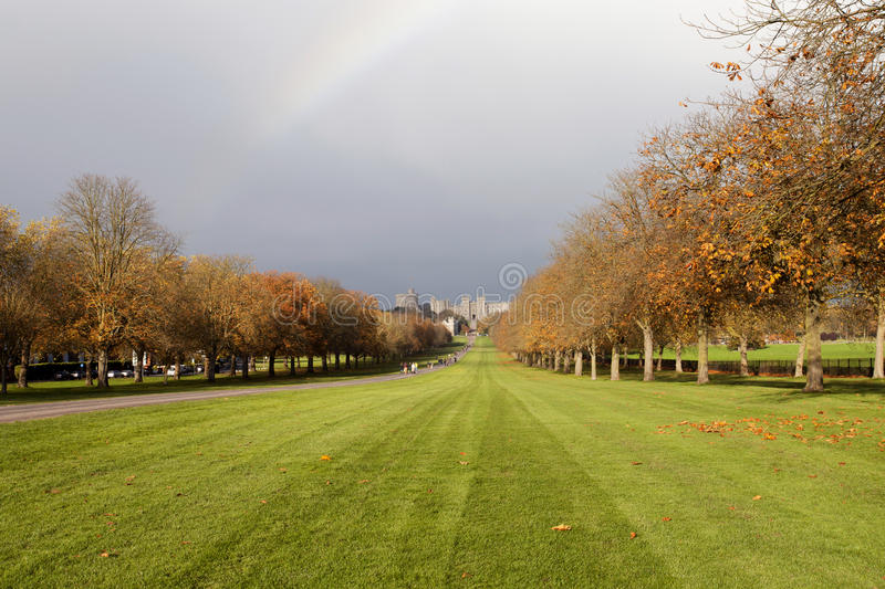 Rainbow over Windsor Castle. A rainbow in the distance looking down the long walk at Windsor Castle royalty free stock images
