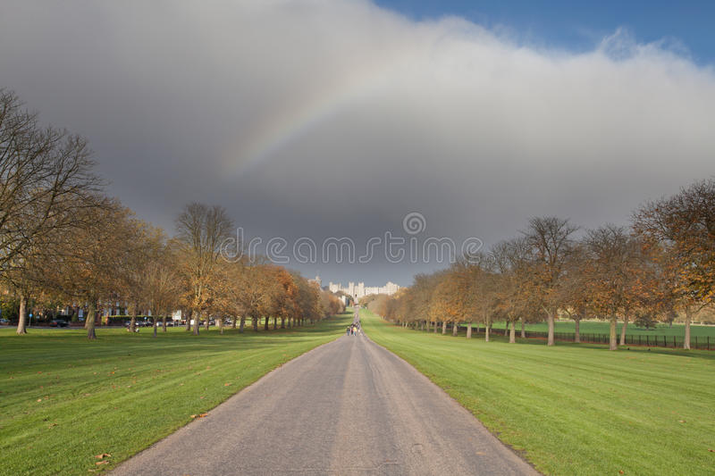 Rainbow over Windsor Castle. A rainbow in the distance looking down the long walk at Windsor Castle royalty free stock image