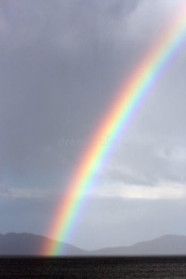 Rainbow over wine glass bay tasmania stock images