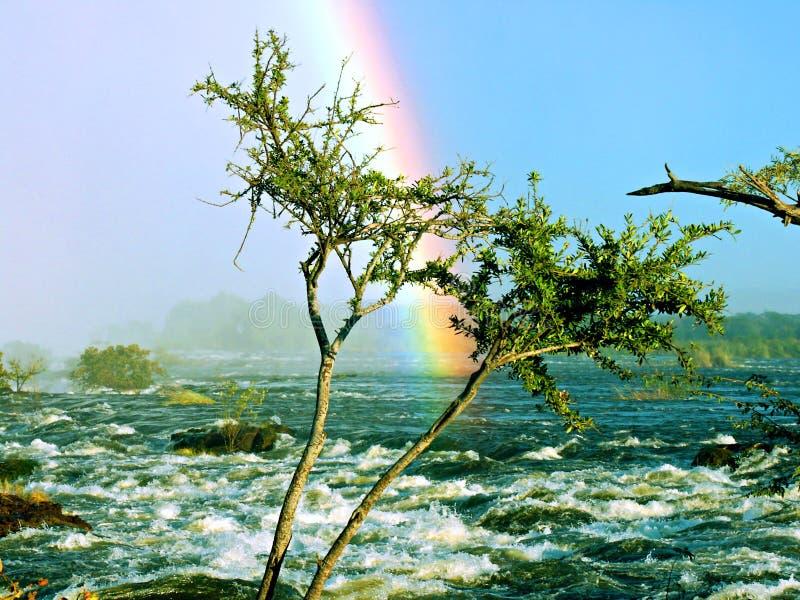 Rainbow on river stock photo