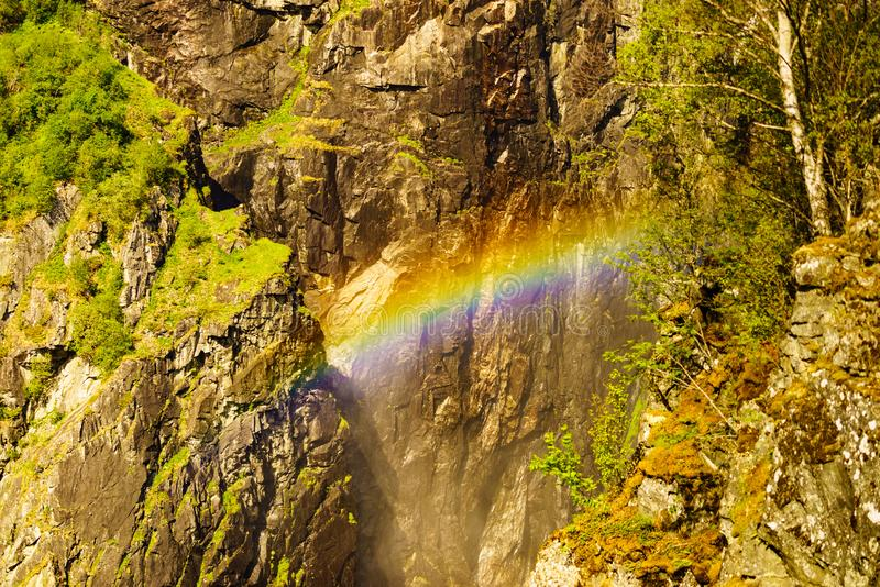 Rainbow in rocky mountains. Rainbow in in rocky mountains in summer, Mabodalen valley Norway. National tourist Hardangervidda route stock images