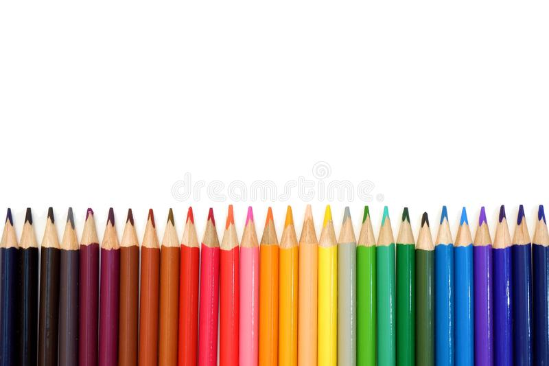 Rainbow from set of colored pencils on white background close up view royalty free stock images