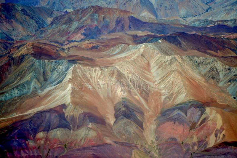 Colorful rainbow mountains in Peru with fairy tale views. Rainbow-shimmering mountainside. An image not like this planet. A unique phenomenon of oxidation of royalty free stock photo
