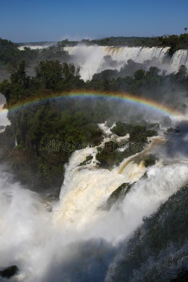Rainbow over waterfall stock images