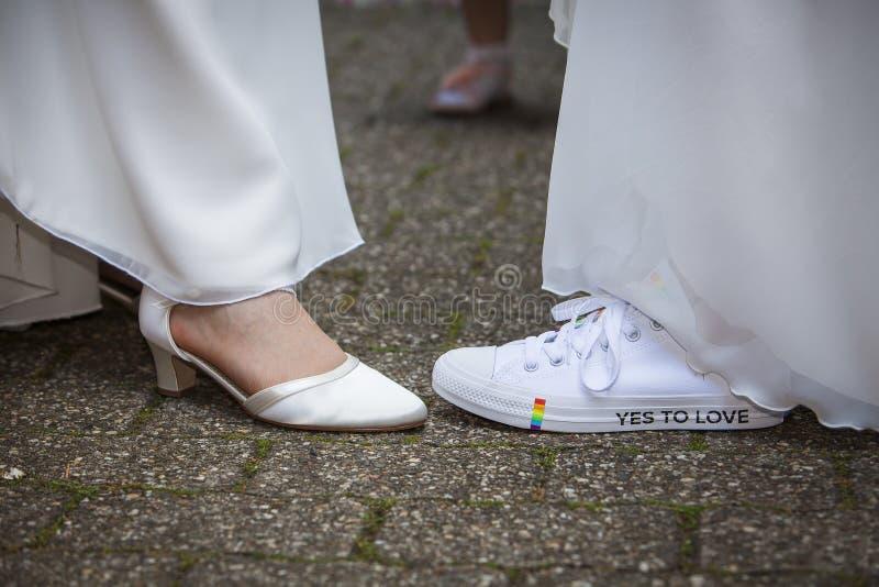 Rainbow lesbian Wedding shoes royalty free stock photos