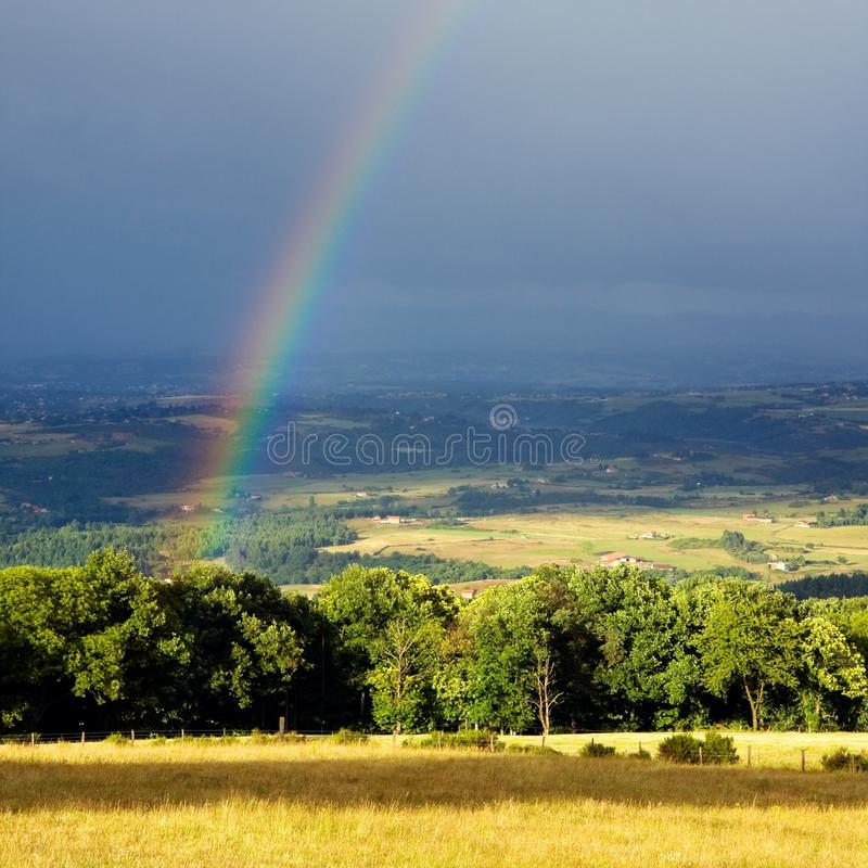 Download Rainbow during a shower stock image. Image of meadows - 22975499