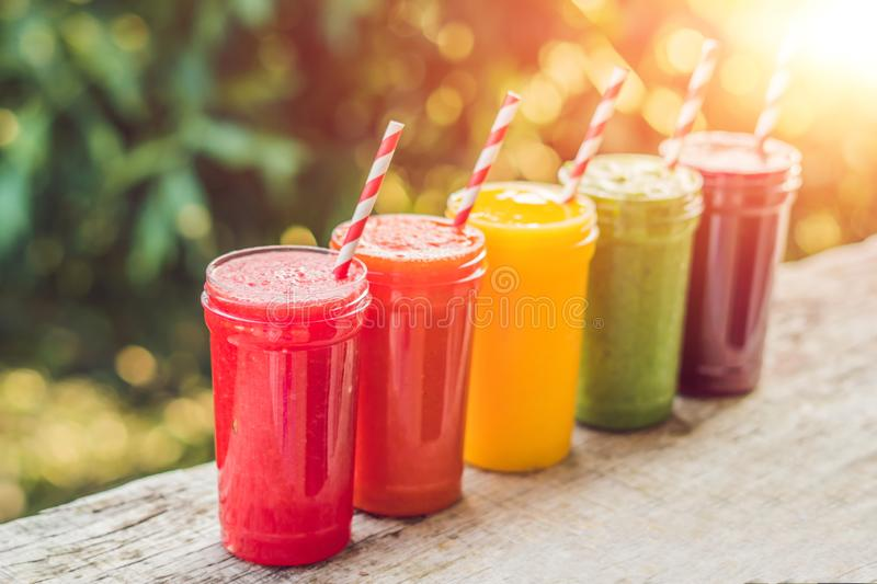 Rainbow from smoothies. Watermelon, papaya, mango, spinach and dragon fruit. Smoothies, juices, beverages, drinks stock photos